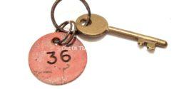 A Brass Baths Locker Key & Plastic Man-Power Board Tag